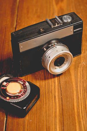 Vintage camera on wooden background photo
