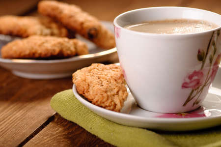 homemade cookies with oatmeal and coffee photo