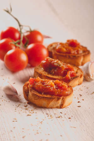 Toast with tomato sauce. Retouching in vintage style. selective focus Stock Photo