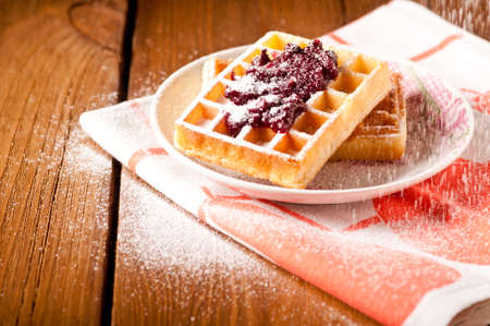 waffles with jam, on the boards