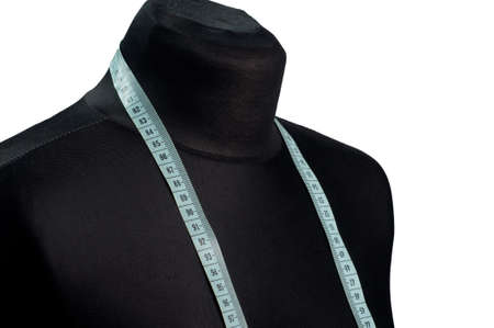 Clothing mannequin with a tape measure on a white  photo