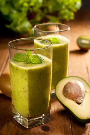 Green smoothie with avocado, kiwi, cucumber and mint photo