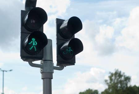 pedestrian walkway: Pedestrian walkway sign with a green traffic light Stock Photo