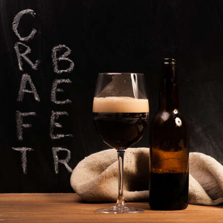 Dark craft beer id the glass photo