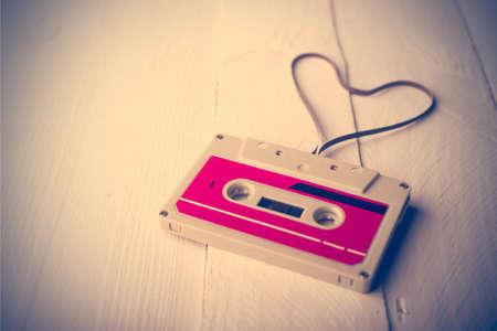 Audio cassette tape in the shape of heart. Retouching vintage. Zdjęcie Seryjne