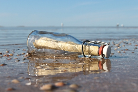 cry for help: message in a bottle stranded on the beach