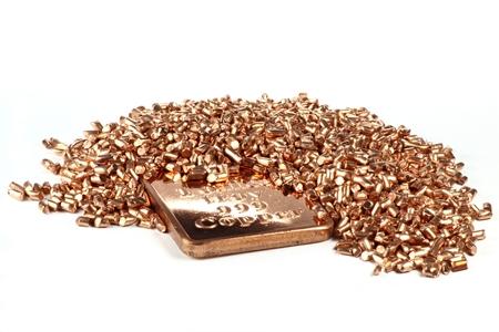granules: copper ingot and granules on white background Stock Photo