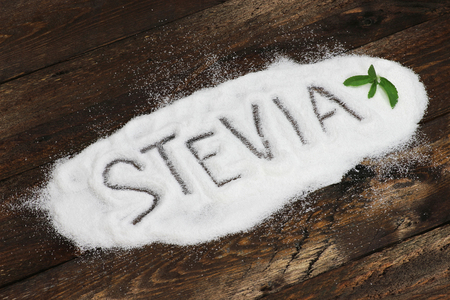 the word written in stevia stevia powder on wooden background