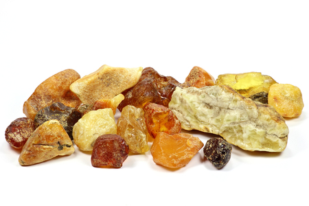 amber coloured: Group of different colored north sea stones amber isolated on white background