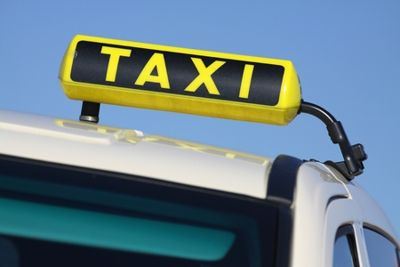 taxi sign: German taxi sign against blue sky