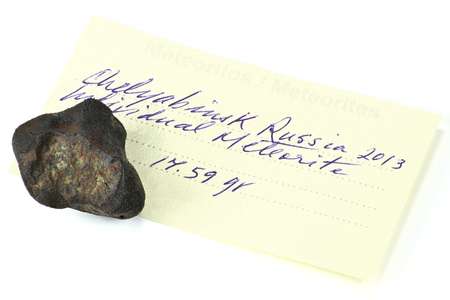 meteorites: Fragment of the Chelyabinsk meteorite 15 February 2013 isolated on white background Stock Photo