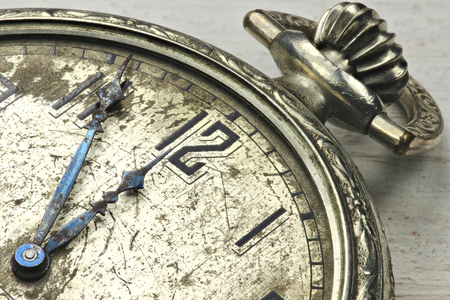 ultimatum: old pocket watch on wooden background Stock Photo