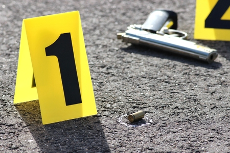crime: id tents at crime scene after gunfight