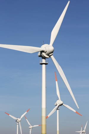 nonpolluting: Wind turbines against blue sky