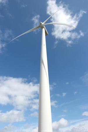 nonpolluting: wind turbine against blue sky