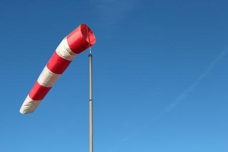 windsock: windsock against blue sky Stock Photo