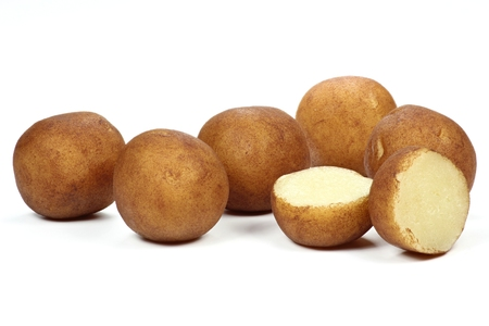 half ball: traditional marzipan potatoes made in Lubeck isolated on white background