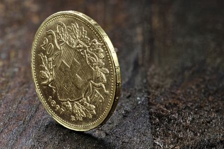 helvetia: Swiss Vreneli gold coin on wooden background Stock Photo