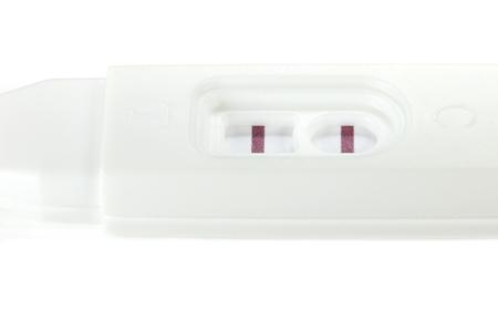 prueba de embarazo: prueba de embarazo positiva aislada en el fondo blanco Foto de archivo