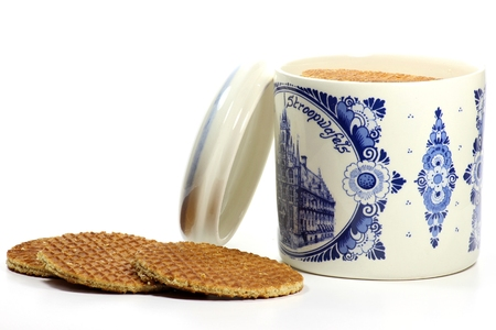 delftware: Traditional Dutch syrup waffles in a Delftware container on white background Stock Photo