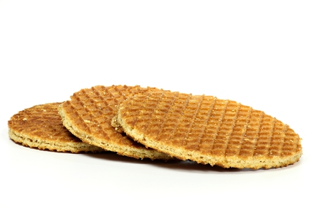 treacle: Traditional Dutch syrup waffles isolated on white background