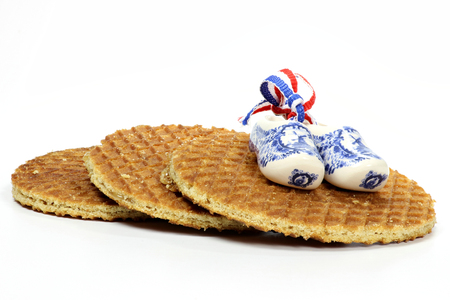 delftware: Traditional Dutch syrup waffles isolated on white background