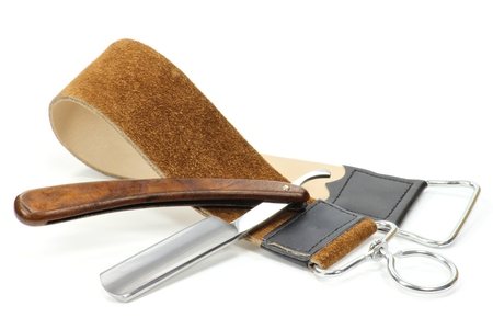 straight razor: Straight razor with leather strop isolated on white background Stock Photo