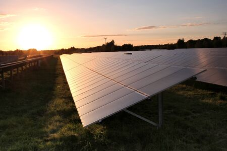 climate: Photovoltaic power station at sunset
