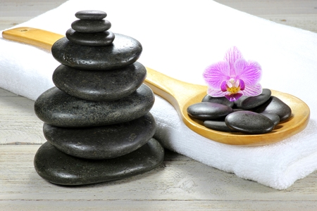 basalt stones for hot stone massage with accessories on wooden background Stock Photo - 51173468