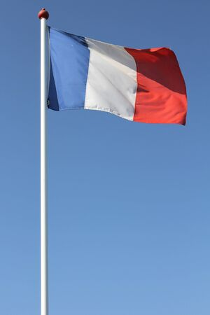 french flag: French flag blowing in the wind Stock Photo