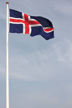 icelandic flag: Icelandic Flag blowing in the wind Stock Photo