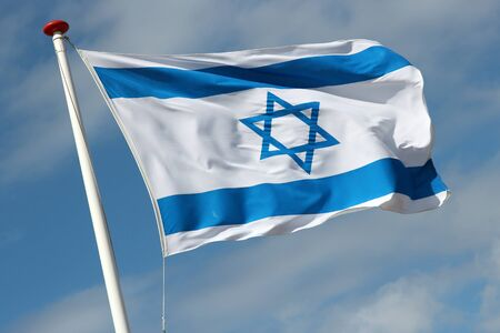 israeli: Israeli flag blowing in the wind