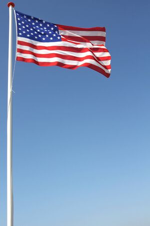flagstaff: US flag blowing in the wind