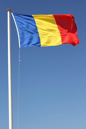 romanian: romanian flag blowing in the wind Stock Photo