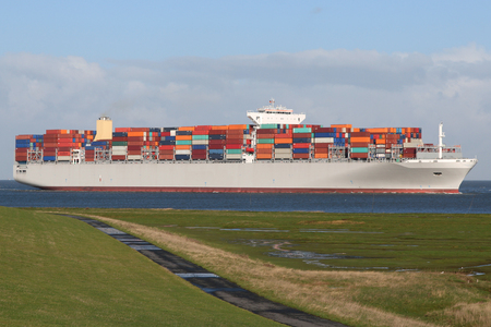 foreign trade: Ultra Large Container vessel on the river Elbe shipping