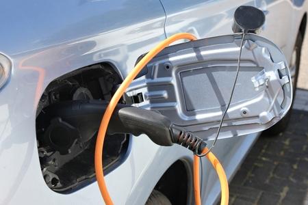 hybrid: hybrid car being charged