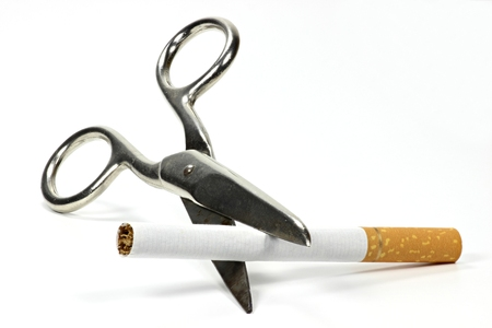 tipped: filter tipped cigarette being cut by scissors