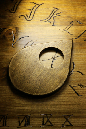 esotericism: planchette on wooden board talking
