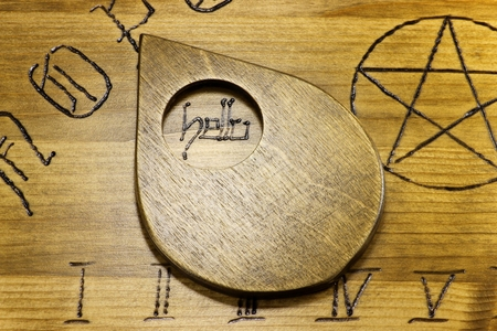 necromancy: planchette on wooden board talking