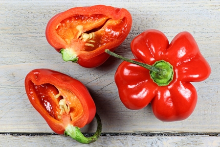 red habaneros on wooden background
