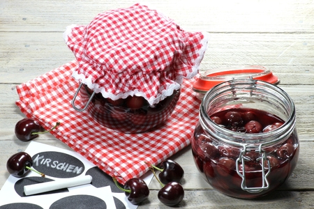 Home canned cherries with German labeling Stock Photo