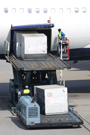 Airliner being loaded with unit load devices