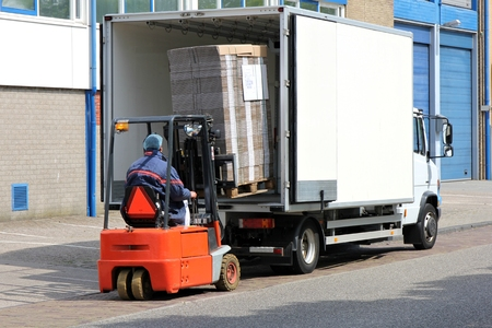 unloading: Delivery truck being unloaded