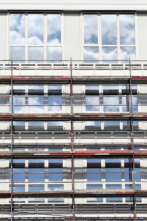 building sector: Scaffolding at office building currently under construction Stock Photo