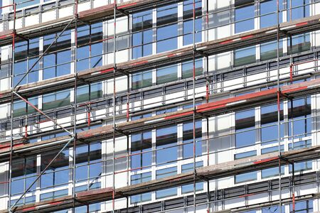 couplers: Scaffolding at office building currently under construction Stock Photo