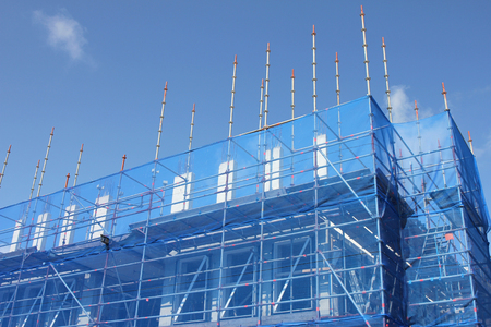 Scaffolding at office building currently under construction Stock Photo
