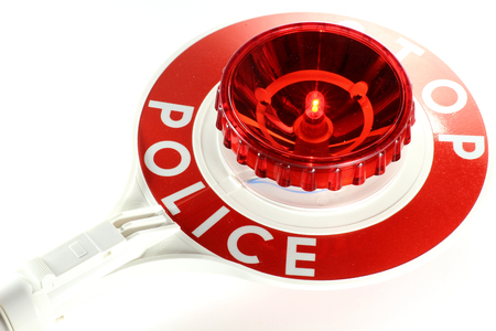 pulled over: Signalling disk isolated on white background
