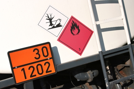 orange-colored plate with hazard-identification number 30 and UN-Number 1202 Stockfoto