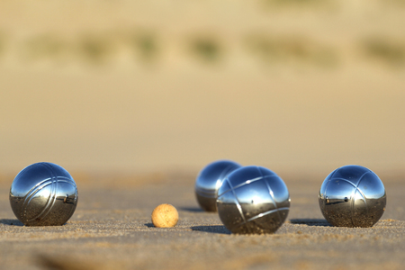 bocce: bocce balls on sandy beach Stock Photo