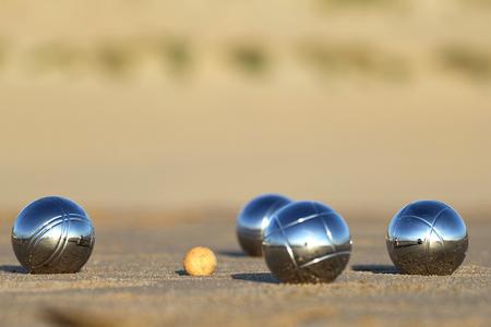 bocce balls on sandy beach Stockfoto
